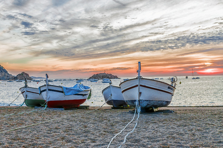 fishing boats on the beach in Tossa de Mar, Spain Stock Photo