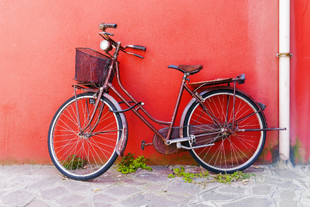 peddle: Old bicycle on a red wall background