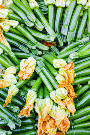 courgettes: Fruit courgettes with flowers Stock Photo