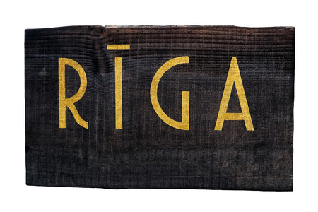 Wooden plaque with the inscription: Riga Stock Photo