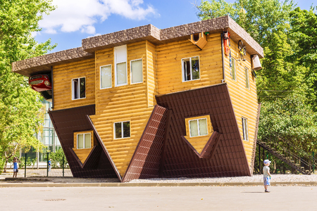 MOSCOW, RUSSIA -5 AUGUST, 2015: Exhibition of Achievements of the National Economy. An unusual house. The House-Perevertysh - a unique interactive attraction Editorial