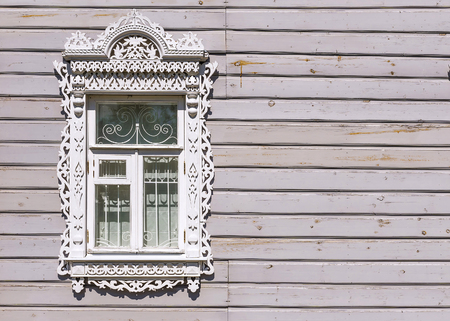 Carved platbands in a Russian wooden house