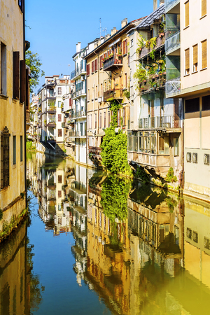 townhouses: The city canal San Massimo runs among residential houses in the centre of the old city Padua, Italy