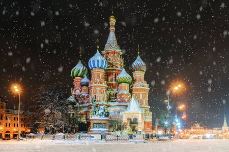 St. Basil's Cathedral in Moscow in winter, Russia. The inscription on the monument in Russian: Citizen Minin and Prince Pozharsky from Grateful Russia
