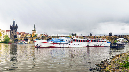 tourist ship on the background of the Charles Bridge in Prague 報道画像