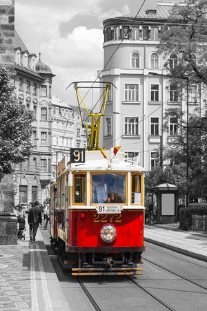 PRAGUE, CZECH REPUBLIC - MAY 22, 2016: Vintage red tram in the old streets of Prague