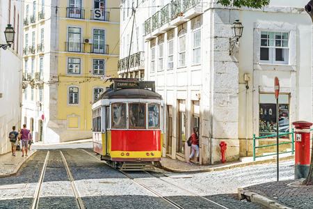 Lisbon, Portugal.Red retro streetcar in the streets in Lisbon 에디토리얼