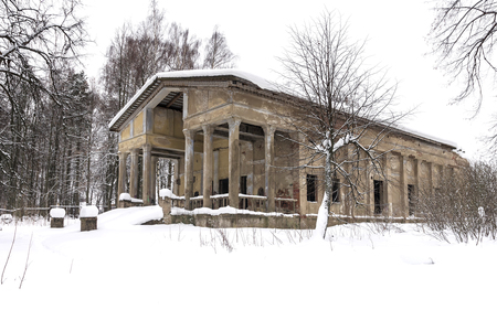 old abandoned building covered with snow