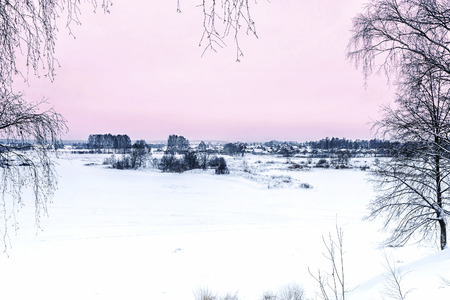 winter snowy landscape with pink sky