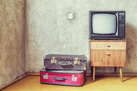 Old room. retro tv and old suitcases 스톡 콘텐츠