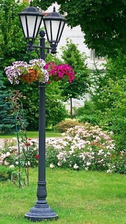garden lantern with flowers.beautiful garden decoration 스톡 콘텐츠