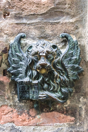 winged lion in venice. original doorbell on the wall