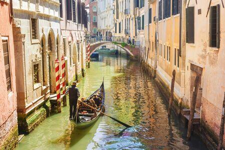 Italy. Venice. Gondola on the picturesque canals in Venice. Banco de Imagens