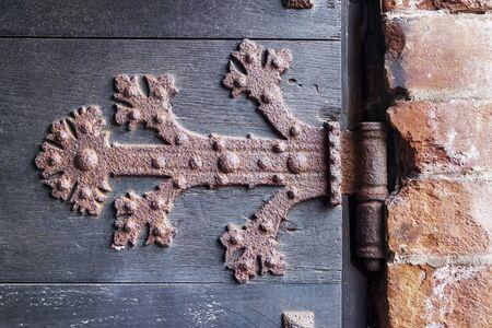 rusty hinge of an old wooden door