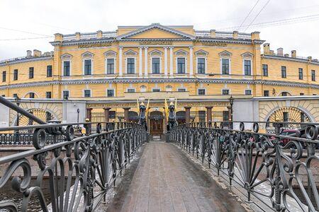 Bank bridge in St. Petersburg, Russia. The inscription on the building in Russian: St. Petersburg State University of Economics