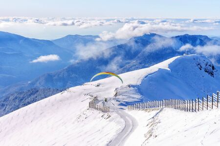 paraglider on the background of snowy mountain peaks