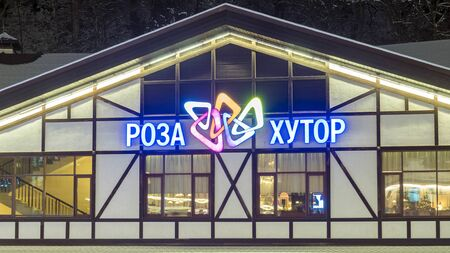 RUSSIA, SOCHI - DECEMBER 5, 2019: neon logo of the ski resort Rosa Khutor on the exterior of the building 新聞圖片