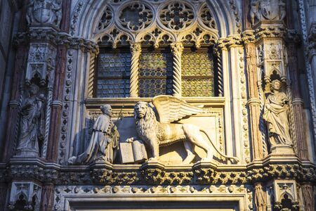 Venice, Italy. Sculpture of a winged lion at the Doge's Palace in Venice