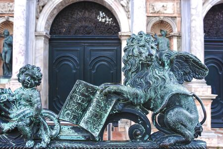 bronze statue of the winged lion symbol of Venice in Saint Mark square