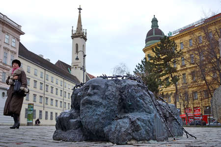 VIENNA, AUSTRIA- JANUARY 2, 2014: A street washing a Jew is part of the monument against war and fascism on Helmut Zil Square in Vienna.
