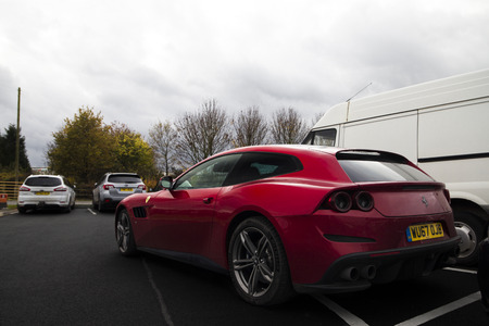 November 2017 - Birmingham, United Kingdom: Ferrari GTC4Lusso family supercar parked at the National Exhibition Centre facilities in Birmingham. Editorial