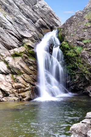 alpine tundra: Small waterfall. Rocks. Transparent water. Polar Ural