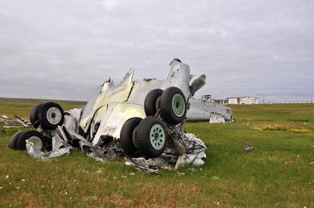 Plane crash. Parts of the destroyed aircraft, landing gear and fuselage, lie in the field
