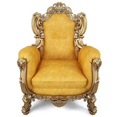 elegant armchair of yellow chamois leather and gold-plated body. isolated on white photo