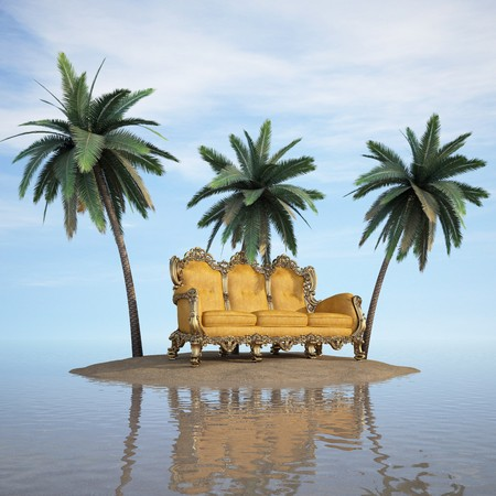 desert island: classic sofa stands on a desert island in the sea.