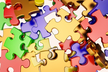 the background unsolved bunch of jigsaw puzzles pieces photo