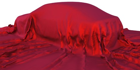 car under the red satin cloth. isolated on white photo