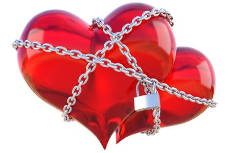 tied up: two glas hearts linked together with silver chain.  Stock Photo