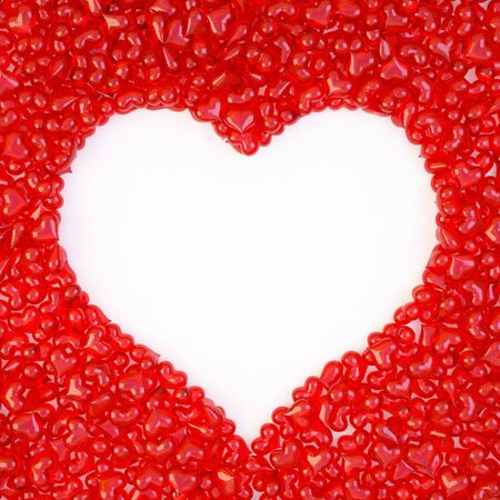 bunch of red candy hearts in the form of a large heart. isolated on white. Stock Photo - 8708723