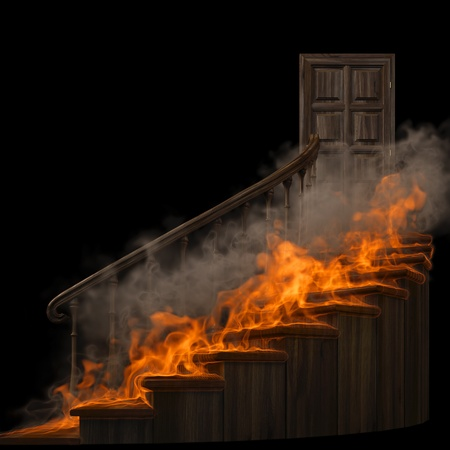 doorway: burning wooden twisted staircase and closed door. isolated on black.
