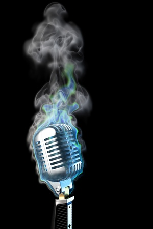 recording studio: old mic in blue flames. isolated on black. Stock Photo