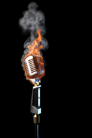 old mic in flames. isolated on black. photo