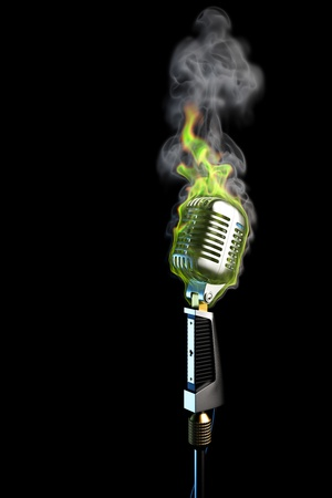 old mic in green flames. isolated on black. photo