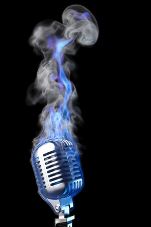 burning: old mic in blue flames. isolated on black. Stock Photo
