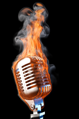 multimedia background: old mic in flames. isolated on black.