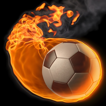flaming soccer ball. isolated on black photo