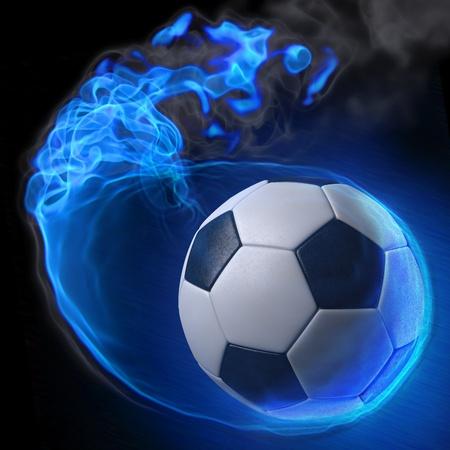 balón de fútbol mágico en la llama azul.