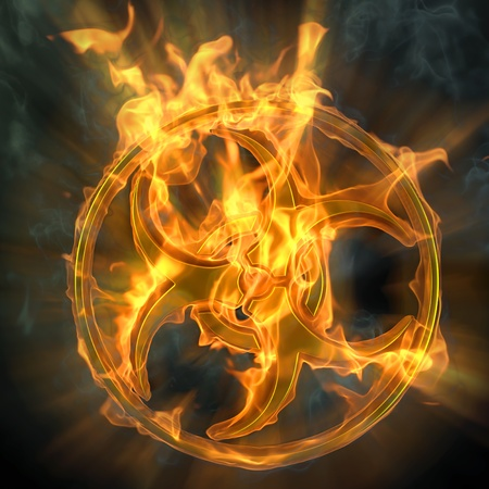 toxic substance: flaming biohazard sign. isolated on black. Stock Photo