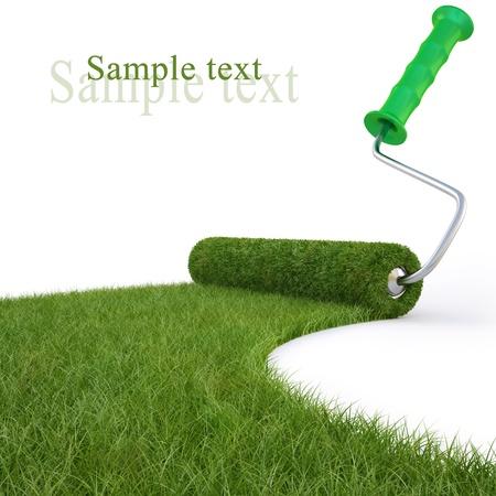 decorando: rodillos dibuja el camino de la hierba verde. aislado en blanco.