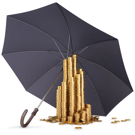 investment protection: pile of gold coins under the umbrella. isolated on white. Stock Photo