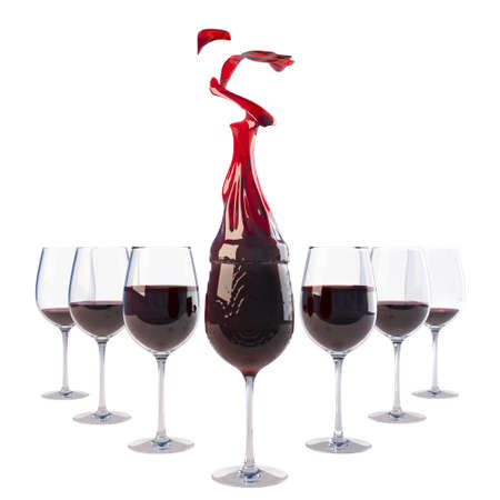 group of glasses with the wine, one of which is burning the flame from the wine. isolated on white. photo