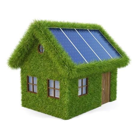 Casa de la hierba con paneles solares en el techo. aislado en blanco.