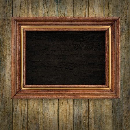 picture frame on wall: wooden picture frame on the old wooden wall.