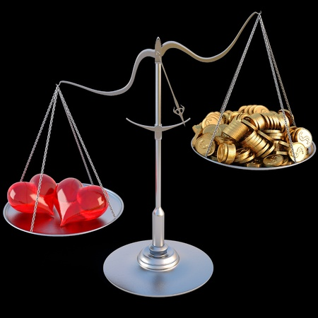 outweigh: two loving hearts outweigh the pile of gold coins on the scale. isolated on black.