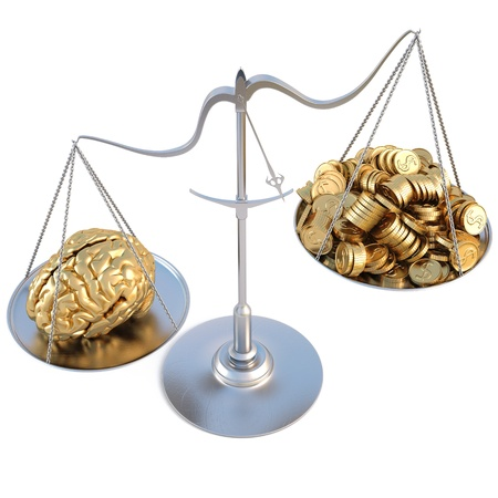 business value: golden brains outweigh the pile of gold coins on the scale. isolated on white.