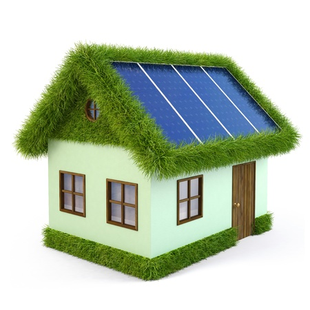 House from the grass with solar panels on the roof. isolated on white. photo
